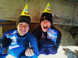 Andy and hiking buddy, Taylor, celebrating on top of Pikes Peak with Sponge Bob party hats, Little Debbie cakes, candles that wouldn't light due to lack of oxygen and strong winds, and freeze dried Neopolitan ice cream